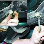 Ослабьте затяжку гайки крепления держателя троса на балке заднего моста и выньте трос из держателя
